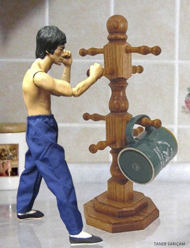 Cartoon: bruce lee (medium) by tanerbey tagged holder,cup,dummy,trainning,lee,bruce